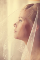 Portrait of a beautiful smiling blonde bride
