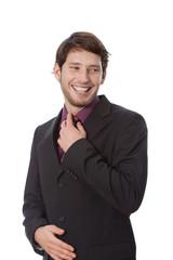 Man correcting a tie