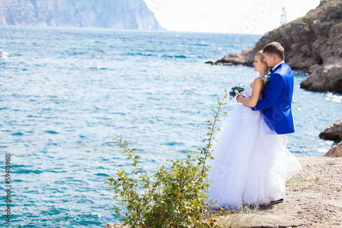wedding: bride and groom on the seashore