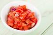 Tomato Salsa - Mexican tomato dip in a white bowl.