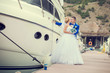 Beautiful bride and groom wedding couple near sea yacht