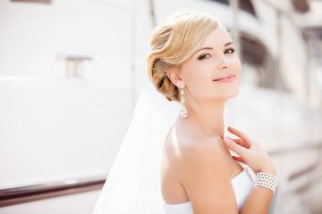 Happy bride posing in her wedding day
