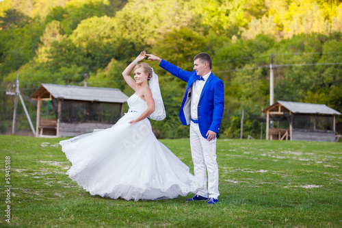 Newly married couple dancing outdoor