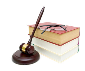 gavel, a stack of books and glasses on white background
