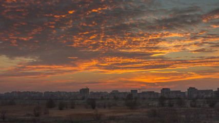 Timelapse with sunset over Bucharest suburbs, Romania..