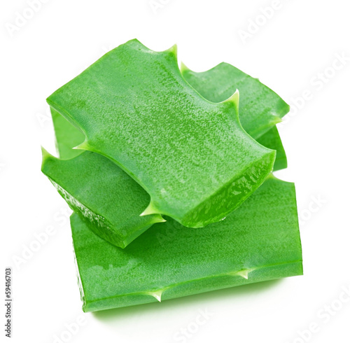 aloe vera leaf and slices isolated on white background