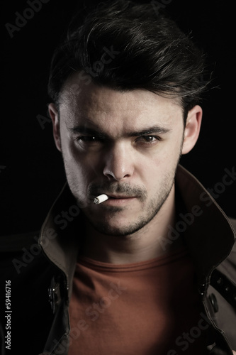 Portrait of a handsome man smoking a cigarette