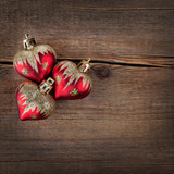 Christmas concept. Red  heart over rustic wooden background