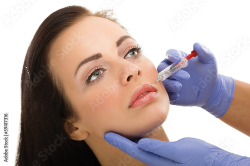 botox shot in the female cheek