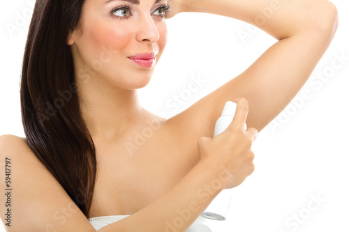 Young woman applying deodorant