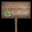 Christmas green fir tree on a wooden board