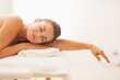 canvas print picture - Relaxed young woman laying on massage table