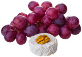 cheese and grapes on white background