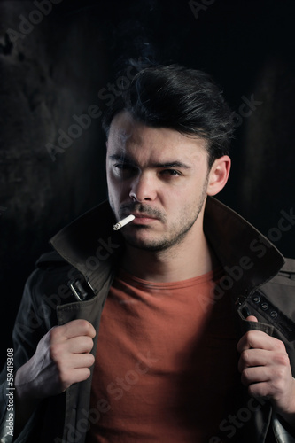 Handsome man smoking a cigarette