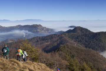 Mountain hikers on return to foggy walley