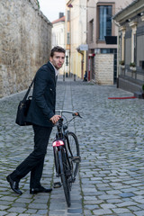 young business man with his bicycle