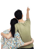 Young couple pointing at wall