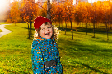 Laughing happy little boy in park
