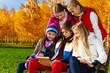 Teens with digital tablet