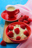 Fresh raspberries on the curd and coffee. Selective focus