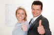business partners motivated show thumbs up.