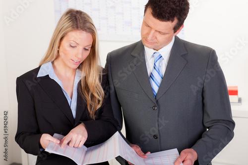 businessmen consult.