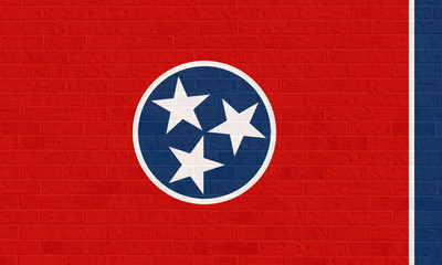 Tennessee state flag on brick wall