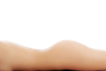 Beautiful naked woman lying on floor.