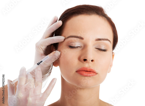 Beautiful woman's face is prepared to medical surgery.