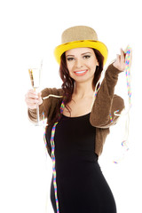 Beautiful woman in black dress,golden hat and champagne.