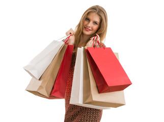 Shopping woman holding shopping bags looking at camera