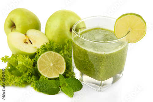 Glass of green vegetable juice apple and lime close up