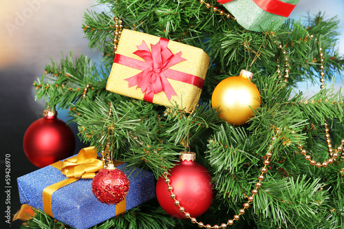 Gifts on Christmas tree on room background