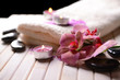 Still life with beautiful blooming orchid flower, towel and spa