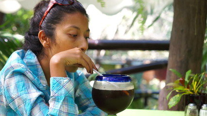 Young woman enjoying a drink
