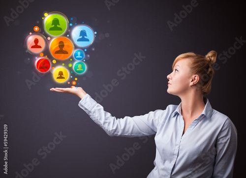 Social network icons in the hand of a businesswoman