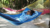 Woman relaxing in a Hammock