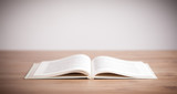 Fototapety Open book on wooden deck