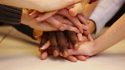 Students stacking hands for support
