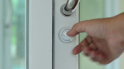 Close up opening door with hand