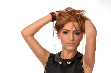 Glamour portrait of a Middle Eastern woman playing with her hair