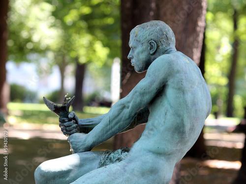 Leinwanddruck Bild Belgrade, Serbia. Sculpture of man in the fountain