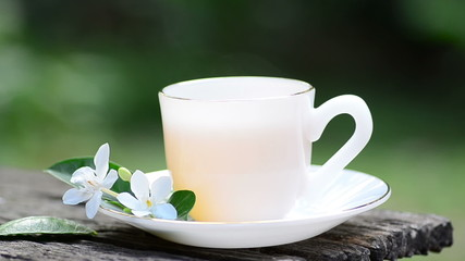 Hot tea with flower in morning time