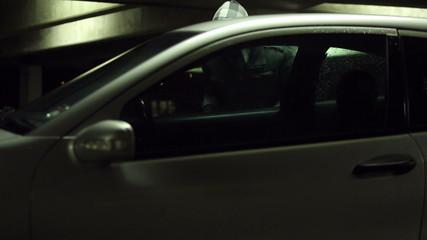 Car thief being deterred by car alarm