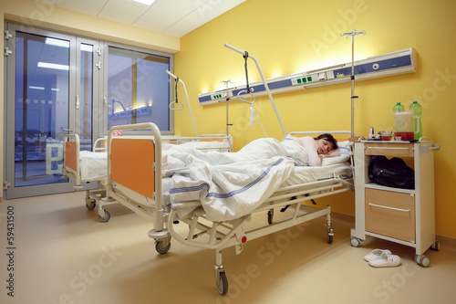 sad middle-aged woman lying in hospital