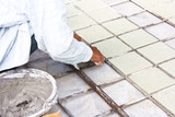 Ttiles floor installation.Worker installs ceramic tile