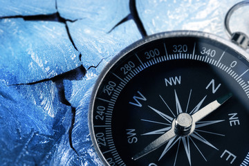 Compass on icy wall