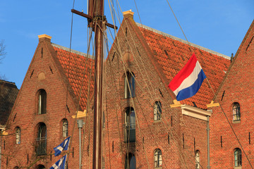 Old warehouses and a Dutch flag