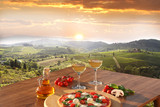 Italian pizza and glasses of white wine in Chianti, Italy