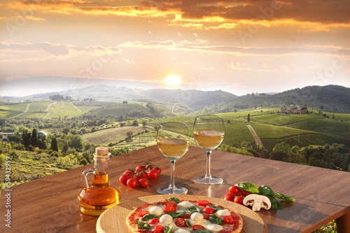Italian pizza and glasses of white wine in Chianti, Italy - 59432959